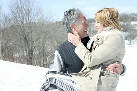 winter woman: Portrait of happy senior couple in winter season