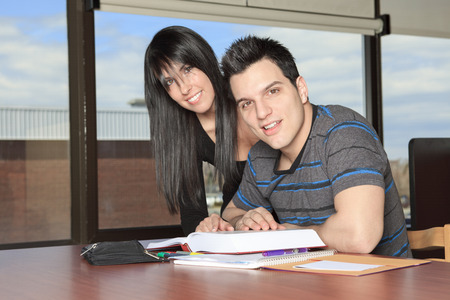 20 years old: A 20 years old couple student studying.