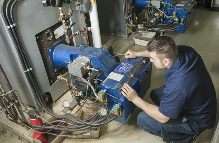 repairman engineer or inspector who check the system. Standard-Bild