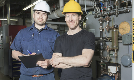 manometer: repairman engineer or inspector who check the system. Stock Photo