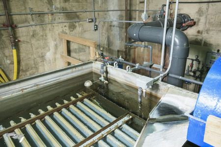 wastewater: Wastewater aeration basin bubbling in a building