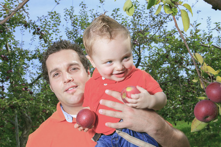 Father giving piggyback ride to his son Stock Photo