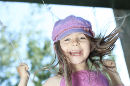 a little girl spending time outdoor on a warm summer day. photo