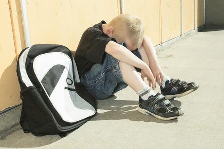 A boy bullying in school playground. very sad! Stock Photo