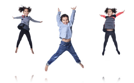 leaping: A cute african american little boy jump isolated on white background