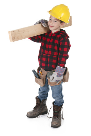 pretending: Young boy pretending to be a carpenter