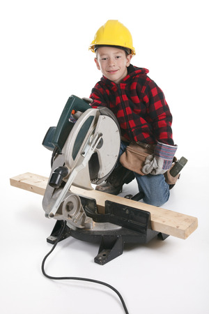 make belief: Young boy pretending to be a carpenter