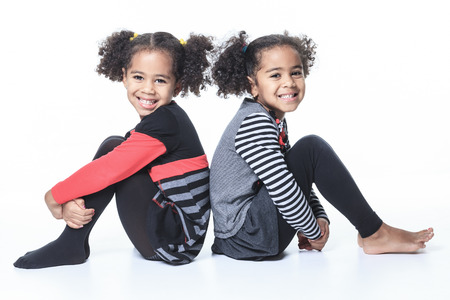 A cute african american twin on white background