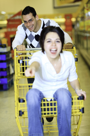 Young Family couple choosing food in supermarket.
