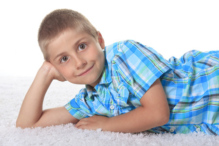 mischievious: Young Boy Lying down in Studio