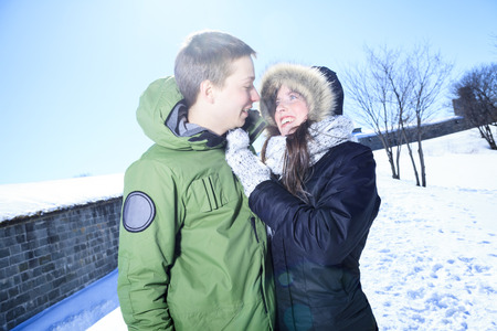 A Happy winter  couple.  in snowy forest. photo