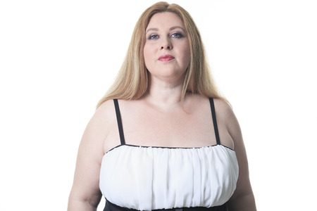 large build: A fashion woman in studio white background Stock Photo