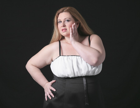 large build: A fashion woman in studio black background
