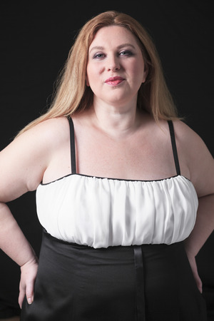 A fashion woman in studio black background photo