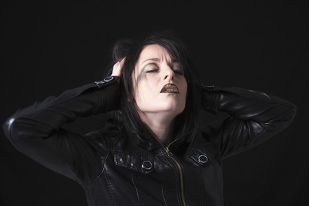 A gothic woman over a dark background,