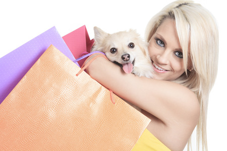beauty shop: A Beautiful woman friends fashion, holding dog in studio gray background