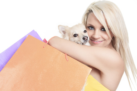 A Beautiful woman friends fashion, holding dog in studio gray background photo