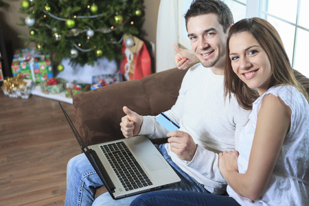 A Couple using credit card to shop on internet photo