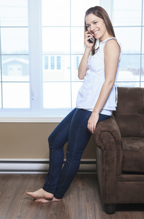 A Portrait  of a beautiful young woman, talking on the phone photo