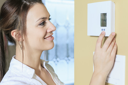 adult footprint: A woman set the thermostat at house.