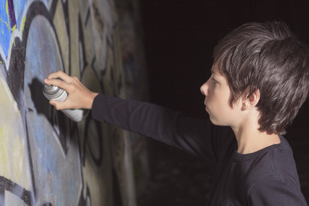 schoolhouse: A teen made some graffiti on the wall of a tunnel Stock Photo