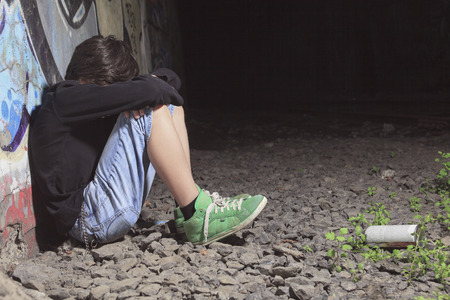 bad behavior: A teen made some graffiti on the wall of a tunnel Stock Photo