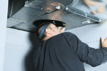 A ventilation cleaner check for dust on it. Archivio Fotografico