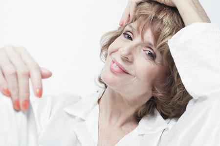 A senior woman in front of white background photo