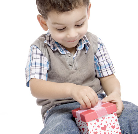 receives: The little boy receives a beautiful gift