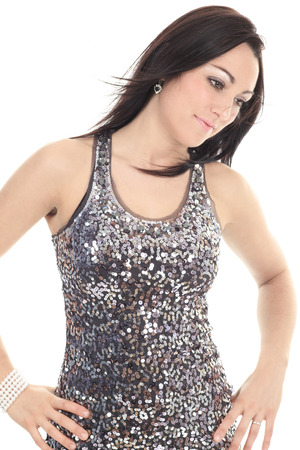 silver dress: A young beautiful woman in silver dress posing at studio over white background.
