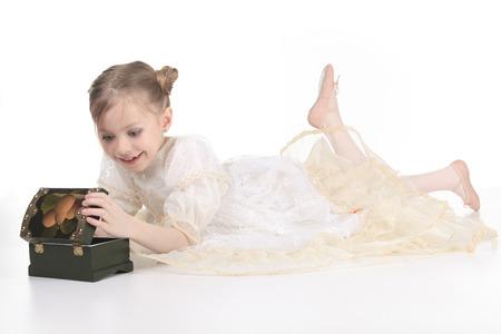 tresure: Beauty Ballerina young girl over white background