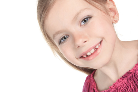A beautiful girl child over a white background. Stock Photo