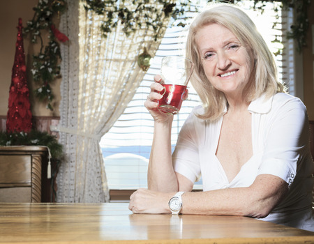 65 years old: A Retired woman on the kitchen table