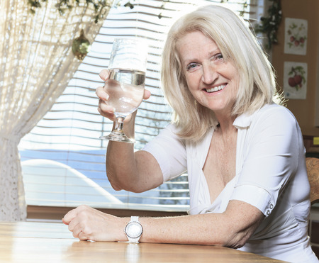 A Retired woman on the kitchen table