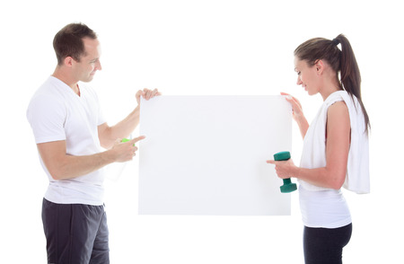 Two training adult holding a cardboard in studio.