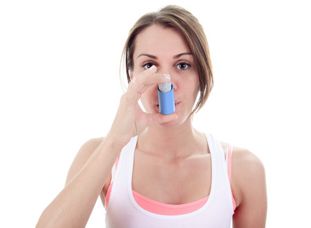 health symbols metaphors: An asthma young adult over white background Stock Photo