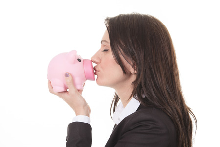 Glasses sale concept. Happy woman kissing piggy bank wearing eyewear glasses. Mixed race Asian Chinese  Caucasian female model isolated on white background. photo