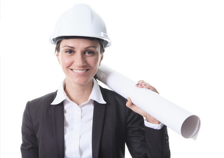 Attractive architect holding blueprints and wearing helmet. All on white background.