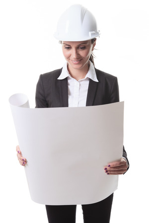 building sector: Attractive architect holding blueprints and wearing helmet. All on white background.
