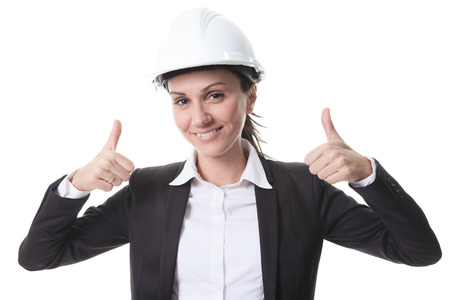 building sector: Attractive architect wearing helmet. All on white background.