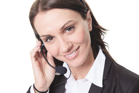 hot secretary: Smiling attractive woman with headphone isolated against white background
