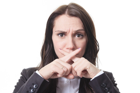 confidentiality: A business woman with a sign of x in front of her mouth for confidentiality