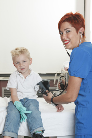 A Doctor Examining cute little boy photo
