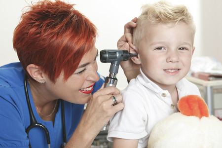 examining: A Doctor Examining cute little boy