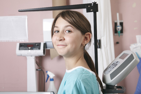 general pediatrician: A young girl get measure in the hospital pediatrician Stock Photo