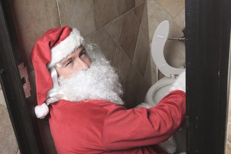 sic: A santa claud sic in the bar toilet Stock Photo