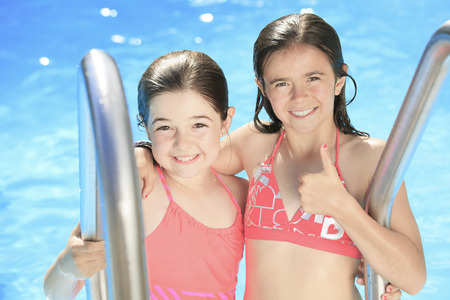 aciculum: Child play at the pool place in a beautifull summer Stock Photo