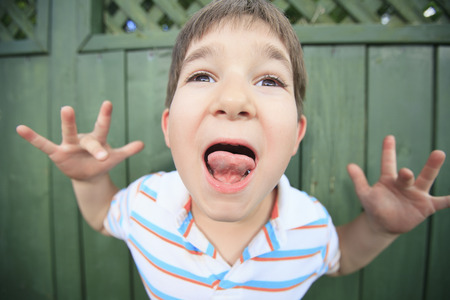 A boy with a funny face expression photo