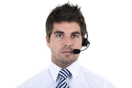25 29: Portrait of handsome male customer service representative wearing headset isolated over white background