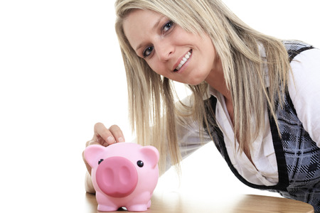 coinbank: Business woman saving in a piggybank - isolated over a white background